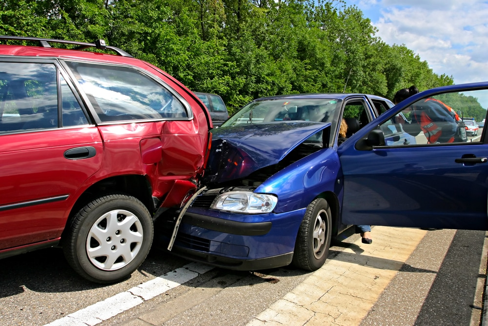 Car collision on the road, front-end crash