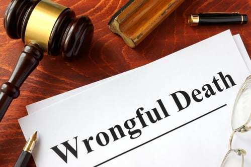 wrongful death printed on paper near gavel
