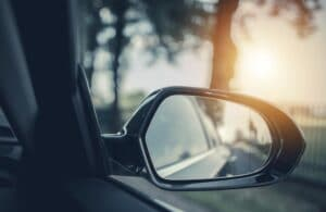Car rearview mirror while car is on road